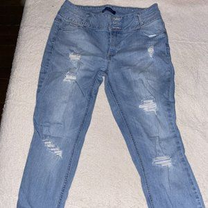 Women's jeans with multiple tears.